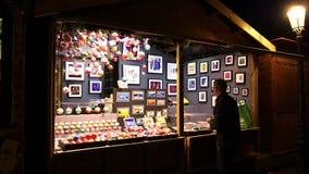 Man arranging Christmas Market installation before inauguration. STRASBOURG, FRANCE - CIRCA 2018: Adult man arranging the Christmas market stalls with toys stock footage
