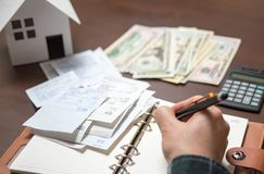 A man arranging receipts. Home Economics Concept Stock Photo