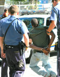 Man Arrested. African american man arrested for a serious crime Stock Images