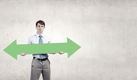 Man with arrow in his hands Royalty Free Stock Image