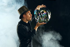 Man artist blowing many soap bubble Royalty Free Stock Image