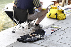 Man artist painting on the street Royalty Free Stock Photography