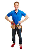 Man as an artisan smiling. With his hands on the hips royalty free stock images