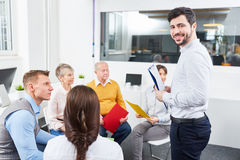 Man as coach in team building workshop Stock Photography