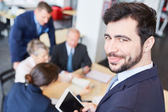 Man as consultant with team Royalty Free Stock Image