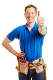 Man as a craftsman holding thumbs up Royalty Free Stock Photos