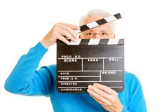 Man as director looks through movie flap. Man as a director looks through an open movie flap stock images