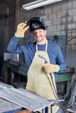 Man as experienced welder. With competence in metallurgy workshop royalty free stock photo