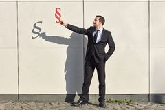 Lawyer holds a paragraph. Man as a lawyer holds a paragraph as a symbol of the law stock photos