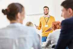 Man as lecturer and consultant. Gives lecture at business training seminar stock photography