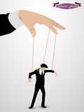 Man as a marionette controlled Stock Image