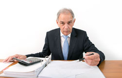 Man as an official, representative, advocate or reseller. Sitting at a desk Royalty Free Stock Image