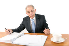 Man as an official, representative, advocate or reseller. Sitting at a desk Royalty Free Stock Photography