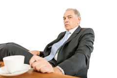 Man as an official, representative, advocate or reseller. Sitting at a desk Royalty Free Stock Photo