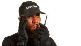 Man as security guard giving alarm. With his radio set Royalty Free Stock Image