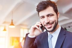 Startup business consulting founder. Man as startup business consulting founder calling with smartphone Stock Image