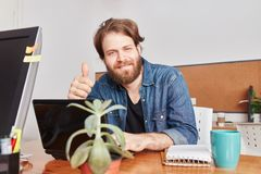 Man as successful founder with thumbs up. At programmer startup Royalty Free Stock Photos