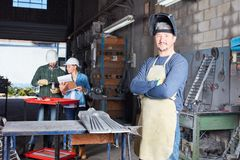 Man as worker and metalworker with experience. In metallurgy workshop Royalty Free Stock Photography