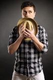 Man ashamed covering with a hat Royalty Free Stock Image