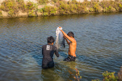 Man asia local fisher working by cast a net. In thailand royalty free stock photo