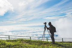 Man asians travel relax in the holiday. Photograph landscape on the Moutain.Thailand. Man asians travel relax in the holiday. Photograph landscape on the Moutain stock photos
