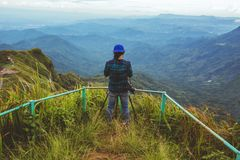 Man asians travel relax in the holiday. Photograph landscape on the Moutain.Thailand. Man asians travel relax in the holiday. Photograph landscape on the Moutain stock photo