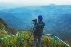 Man asians travel relax in the holiday. Photograph landscape on the Moutain.Thailand. Man asians travel relax in the holiday. Photograph landscape on the Moutain royalty free stock image
