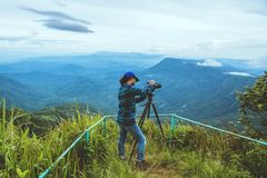 Man asians travel relax in the holiday. Photograph landscape on the Moutain.Thailand. Man asians travel relax in the holiday. Photograph landscape on the Moutain royalty free stock photo