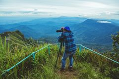 Man asians travel relax in the holiday. Photograph landscape on the Moutain.Thailand. Man asians travel relax in the holiday. Photograph landscape on the Moutain stock images