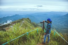 Man asians travel relax in the holiday. Photograph landscape on the Moutain. Thailand royalty free stock images