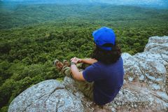 Man asians travel relax in the holiday. View mountain nature on the cliffs. Travel nature. Travel relax stock photography