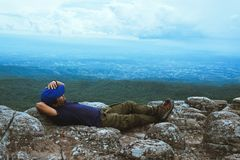 Man asians travel relax in the holiday. View mountain nature on the cliffs. Travel nature. Travel relax royalty free stock photos