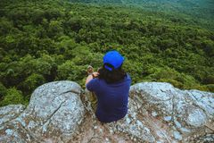 Man asians travel relax in the holiday. View mountain nature on the cliffs. Travel nature. Travel relax royalty free stock image