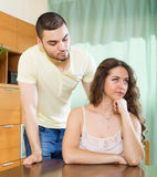 Man asking for forgiveness from woman Stock Photos