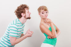 Man asking for forgivness. Conflicted couple. Royalty Free Stock Images