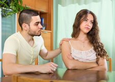 Man asking for forgivness from woman Stock Photo