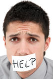 A man asking for help. A young businessman with a band on his mouth Stock Images