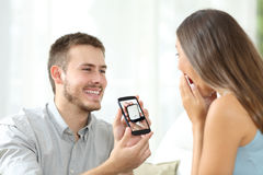 Man asking marriage with a smart phone Royalty Free Stock Photography
