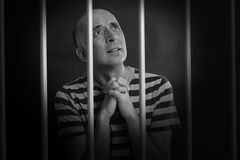 Man asking for mercy in prison Stock Photography