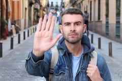 Man asking something/someone to stop.  royalty free stock image