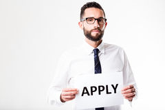 Man asking you to apply for something. Using a sign Royalty Free Stock Photo