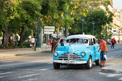 A man asks for a ride in an old american car still used as a taxi in Old Havana Royalty Free Stock Photography
