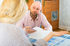 Man asks woman to sign document Royalty Free Stock Photo