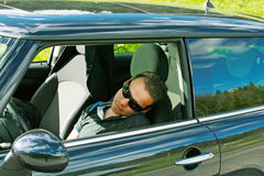 Man asleep in a car Stock Image