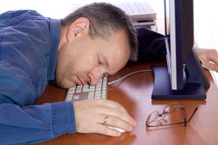 Tired computer guy Royalty Free Stock Image