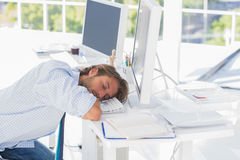 Man asleep at his desk Stock Images