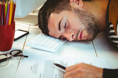 Man asleep at his desk Royalty Free Stock Photography