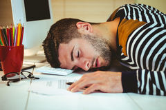 Man asleep at his desk Royalty Free Stock Photo