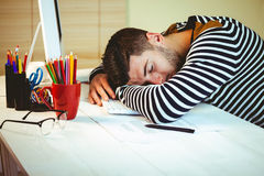 Man asleep at his desk Stock Photography