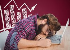 Man asleep at laptop and white graph against maroon background Royalty Free Stock Images